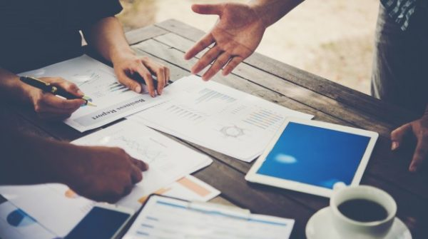 group-business-people-analysis-with-marketing-report-graph-young-specialists-are-discussing-business-ideas-new-digital-start-up-project_1150-1818